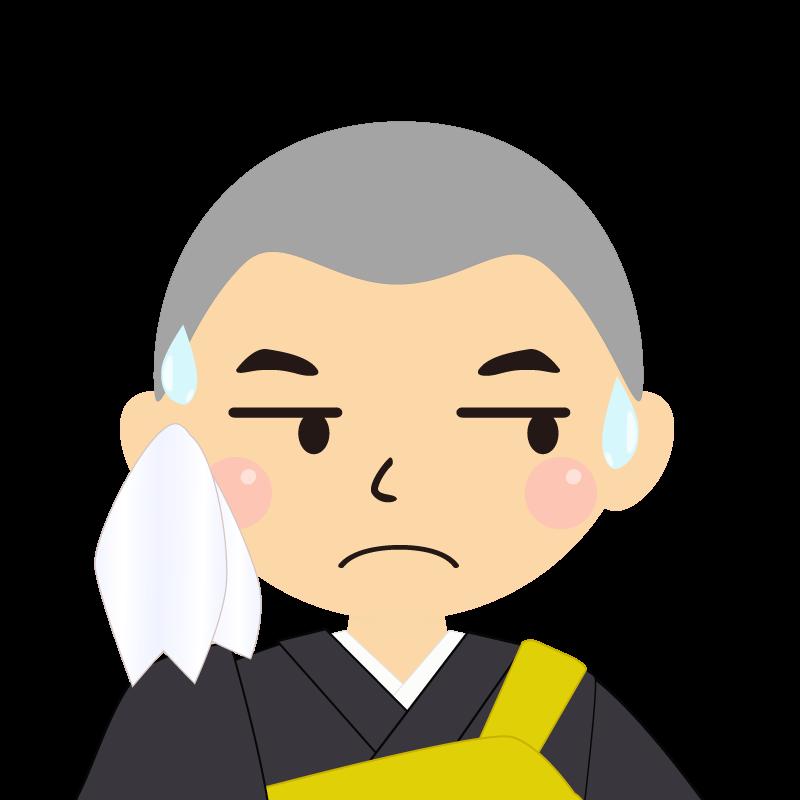 画像:坊主頭の男性・僧侶・法衣 目線を外す