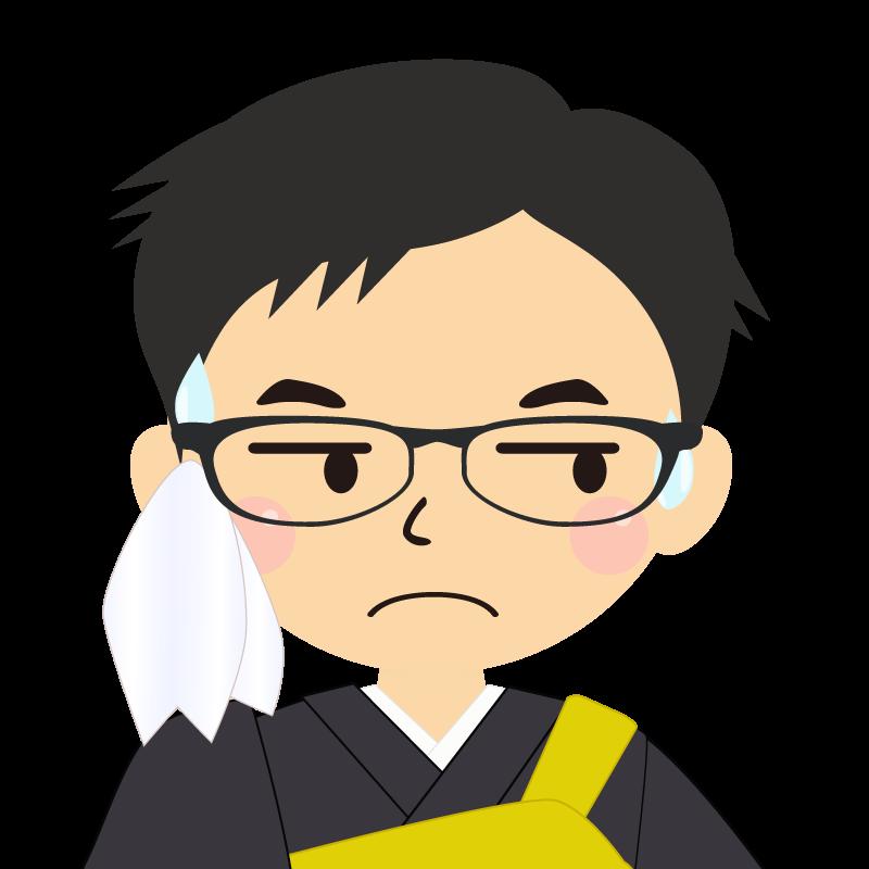 画像:短髪の男性・僧侶・法衣 眼鏡 目線を外す