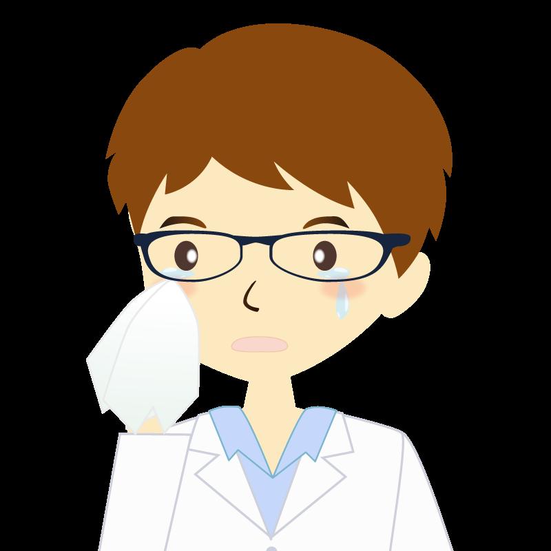 画像:白衣を着た男性・パーマ頭 眼鏡 涙